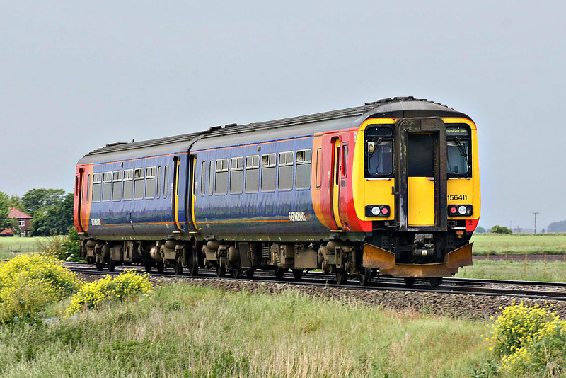 Class 156 411 heads towards Manea Station at Welney Road AHB on 1R86 Norwich - Liverpool Lime Street, 24/05/14.