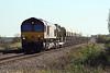 66151 approaches Welney Road AHB on 6M70 Chesterton Junction - Mountsorrel LaFarge S/D empties, 15/10/11.