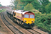 66107 rounds the bend from March Station on a rake of westbound ECC stone empties, 12/05/00.