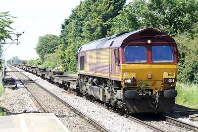 66154 passes Manea on a lightly loaded 4L45 Wakefield Europort - Felixstowe South, 08/06/21.