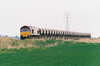 66007 passes Australia Farm No.64 OC on 6M12 Bishops Storftord stone empties, 17/05/02.