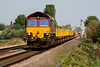 66079 heads east at Welney Road LC with a rake of Salmon/JNA's, 30/04/11
