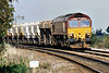 66072 rounds the sharp cambered bend at Ely North Junction on 6L39 Mountsorrel - Trowse Lafarge stone, 13/10/06.