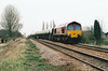 66002 heads west past Harts Drove LC on 6M70 Chesterton Junction - Mountsorrel Redland self-discharge empties, 20/03/02.