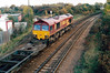 66012 passes March West Junction with a single container on 4L73 Doncaster - Harwich, 27/10/99.