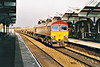 66118 heads east through March on the Peterborough - Trowse Redland stone, 27/03/00.