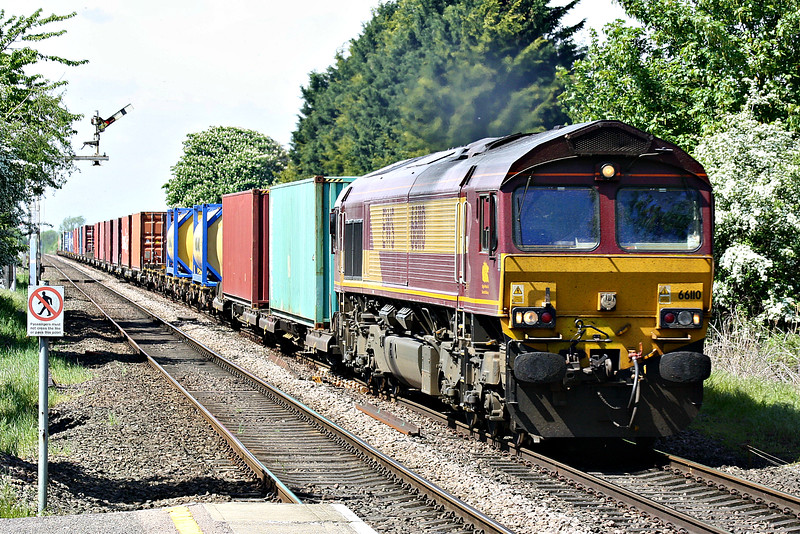 66110 approaches Manea Station on 4L45 Wakefield Europort - Felixstowe South, 09/05/18.