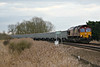 66109 approaches Silt Road LC on 6M29 Harlow Mill - Mountsorrel stone empties, 13/03/17.
