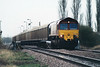 66015 passes Harts Drove LC on 6E57 Felixstowe - Healey Mills empty newsprint vans, 20/03/02.