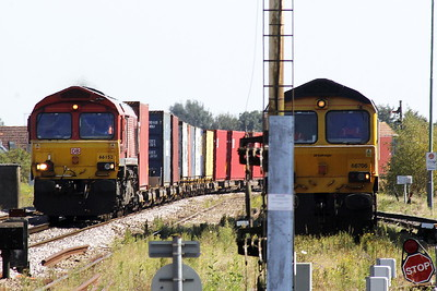 66152 DEREK HOLMES - RAILWAY OPERATOR approaches March East on 4m79 Felixstowe South - East Midlands Gateway, 07/09/21. 66706 NENE VALLEY on the right is the Down Yard super shunter for today.