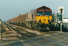 66012 passes Eastrea Road AHB on 6Z26 Stud Farm - Bury St Edmunds ballast, 17/10/03.