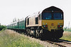 THE FENMAN - 66076 is on the rear of the 'Fenman' as it climbs towards Black Bridge on the return from Wisbech, 12/05/01.<br /> The 'Fenman' Rail Tour ran with 66076/66250 providing power as follows:<br /> 66250 Kings Cross - (via ECML) - Peterborough <br /> 66076 Peterborough - March West Jn - Wisbech  <br /> 66250 Wisbech - March - Ely (via the West Curve)<br /> 66250 Ely - Kings Lynn Yard <br /> 66076 Kings Lynn Yard - Middleton Towers <br /> 66250 Middleton Towers - Kings Lynn Yard <br /> 66076 Kings Lynn Yard - Ely - Cambridge - Hitchin - (via ECML) - Kings Cross.<br /> The train was booked to use the newly-laid East Curve at March but it was not officially opened yet and none of the signals were working - mass panic ensued and the train was only passed to use it at the eleventh hour.<br /> This was the last train ever to run over the entirety of the Wisbech Branch as then existed.
