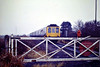 THE ANGLIA VIBRATOR - Class 117 3-car DMU L411 has just passed through the gates at Waldersey Sidings bound for Wisbech on the 'Anglia Vibrator' Railtour, 23/11/85. The joy of any railtour to Wisbech was that, due to all the gates that were crew operated and the low speed limit, it was possible to get ahead of any train a number of times in the course of just 8 miles.<br /> Leg 1 - London  Kings Cross - Potters Bar - Hitchin - Cambridge - Ely - March - March West Jn - Wisbech Goods<br /> Leg 2 - Wisbech Goods - Ely West Jn - Ely North Jn - Wymondham<br /> Leg 3 - Wymondham - North Elmham <br /> Leg 4 - North Elmham - Wymondham<br /> Leg 5 - Wymondham - Brandon - Ely - Cambridge - Hitchin - Potters Bar -  London Kings Cross.<br /> You can easily see what sort of a day it was!