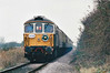 THE CROMPTON PEDIGREE - 33103 pulls away from Newbridge Lane LC on the Wisbech Branch, now on the rear of the 'Crompton Pedigree' Railtour, 21/11/98. This loco was withdrawn in 01/95 and returned to mainline use in 1998. It is now based on the Swanage Railway.<br /> 33103 Crewe - Stafford - Wolverhampton - Birmingham New Street - Proof House Jn - Landor Street Jn - Water Orton - Nuneaton - Hinckley - Wigston North Jn - Leicester - Stamford - Helpston Jn - New England Yard - Peterborough - March West Jn - Whitemoor Jn - Wisbech (Weasenham Lane LC) <br /> 37242 Wisbech - Whitemoor Jn - March West Jn<br /> 33103 March West Jn - Whitemoor Jn <br /> 37242 Whitemoor Jn - March East Jn - Ely West Jn - Ely North Jn - Ely <br /> 33103 Ely - Ely North Jn - Downham Market - Kings Lynn Yard <br /> 37242 Kings Lynn Yard - Middleton Towers <br /> 33103 Middleton Towers - Kings Lynn Yard <br /> 37242 Kings Lynn Yard - Downham Market - Ely North Jn - Ely West Jn - March - Whittlesea - Peterborough<br /> 33103 Peterborough - Helpston Jn - (reverse of outward route) - Crewe.<br /> Due to the signalmen giving wrongly directed, the train sent around the West Curve at Whitemoor Junction and had to stop and reverse, then taking the East Curve.