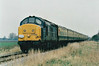THE CROMPTON PEDIGREE - 37242 leads the 'Crompton Pedigree' Railtour along the Coldham Straight on Wisbech Branch, 21/11/98. This loco was withdrawn in 12/99 and scrapped.<br /> 33103 Crewe - Stafford - Wolverhampton - Birmingham New Street - Proof House Jn - Landor Street Jn - Water Orton - Nuneaton - Hinckley - Wigston North Jn - Leicester - Stamford - Helpston Jn - New England Yard - Peterborough - March West Jn - Whitemoor Jn - Wisbech (Weasenham Lane LC) <br /> 37242 Wisbech - Whitemoor Jn - March West Jn<br /> 33103 March West Jn - Whitemoor Jn <br /> 37242 Whitemoor Jn - March East Jn - Ely West Jn - Ely North Jn - Ely <br /> 33103 Ely - Ely North Jn - Downham Market - Kings Lynn Yard <br /> 37242 Kings Lynn Yard - Middleton Towers <br /> 33103 Middleton Towers - Kings Lynn Yard <br /> 37242 Kings Lynn Yard - Downham Market - Ely North Jn - Ely West Jn - March - Whittlesea - Peterborough<br /> 33103 Peterborough - Helpston Jn - (reverse of outward route) - Crewe.<br /> Due to the signalmen giving wrongly directed, the train sent around the West Curve at Whitemoor Junction and had to stop and reverse, then taking the East Curve.