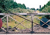 WISBECH - looking south across the level crossing gates, a crossing now devoid of track, 15/07/04.