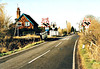 WISBECH BRANCH (10) - When I took these pictures on New Years Day 2006, the Wisbech Branch had been mothballed for about 5 years. Redmoor Lane Level Crossing looking along the road, crossing keeper's cottage on the left. This crossing is higher than the roadway on both sides - great fun on your motorbike!