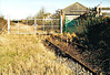 WISBECH BRANCH ( 1) - When I took these pictures on New Years Day 2006, the Wisbech Branch had been mothballed for about 5 years. End of the line - there is no track beyond these gates. This was formerly the site of the GER Goods Yard and now completely built over. The shed on the right is the old Metal Box transhipment shed and the green gate is across their old siding. Trains of steel plate from Trostre were worked into here, sometimes twice a day.