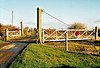 WISBECH BRANCH (11) - When I took these pictures on New Years Day 2006, the Wisbech Branch had been mothballed for about 5 years. The staggered level crossing gates at Waldersey Sidings. These gates are much wider than the little used roadway but close diagonally across the road. Great blackberry bushes here!