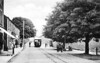 CLOGHER VALLEY RAILBUS -  makes it's way slowly through the streets of Fivemiletown in the 1930's.