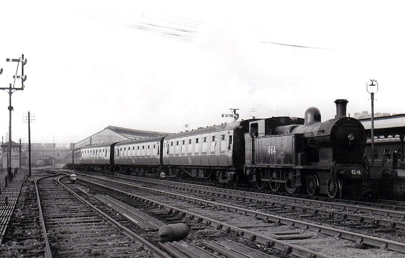 Class B 4 - 464 - 4-6-0T, built 1920 by Beyer Peacock & Co., Works No.6034, as Cork, Bandon & South Coast Railway No.8 - 1925 to GSR, 1945 to CIE, 1946 rebuilt with Belpaire boiler - withdrawn 1963 - seen here at Cork Glanmire Road on ecs of Rosslare Boat Tain, 03/61.