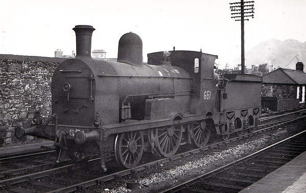 Class G 2 - 651 - M&GWR Class K 2-4-0, built 1895 by Kitson & Co., Works No.3616, as M&GWR No.16 ROB ROY - 1925 to GSR, 1927 rebuilt with round top boiler, 1935 rebuilt with Belpaire boiler, 1945 to CIE, 1951 rebuilt with round top boiler - withdrawn 1959 - seen here at Bray in April 1953.