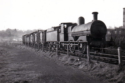 Class J15 - 153 - GS&WR Class 101 0-6-0, built 1868 by Beyer Peacock & Co., Works No.782 - 1904 rebuilt, 1925 to GSR, 1932 rebuilt with superheated Belpaire boiler, 1945 to CIE - withdrawn 1954 - seen here propelling wagons from Clover Meats factory, Waterford, in April 1953.