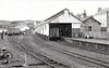 KILLYBEGS - terminus of the branch from Strabane, a railcar just visible behind the trainshed, probably running round the van in the foreground.