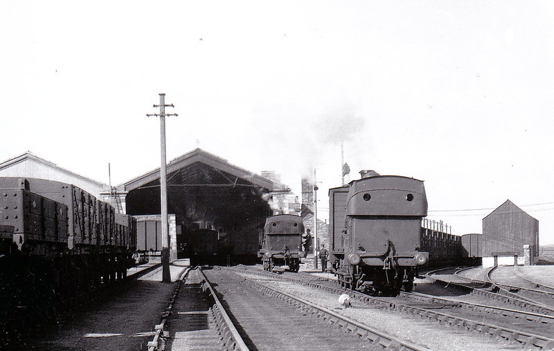 DUNDALK, NEWRY & GREENORE RAILWAY - 6 HOLYHEAD - 0-6-0ST, built 1899 by LNWR Crewe Works - withdrawn 1951 when the railway closed - seen here at Greenore shunting cattle wagons in June 1932, No.4 NEWRY to the left.