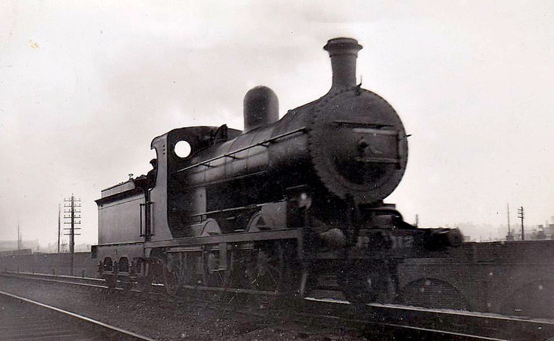 Class NGQ - 112 KEADY - 0-6-0, built 1911 by Nasmyth Wilson - 1931 rebuilt to Class NQGs - 1958 to CIE as No.112N - withdrawn 1963 - seen here leaving Dublin Amiens Street Goods Yard in 1914.