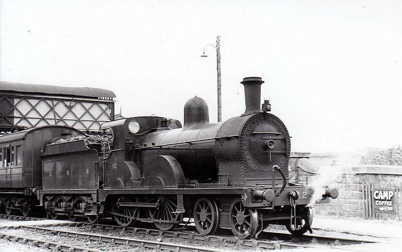 Class PP - 12 ULSTER - GNR(I) 4-4-0, built 1911 by Beyer Peacock - 1930 rebuilt as Class PPs, 1943 rebuilt - 1958 to CIE - withdrawn 1959 - seen here at Strabane in 1937.