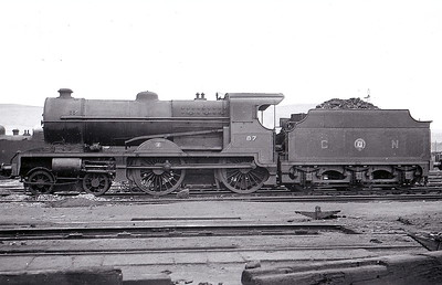 Class V - 87 KESTREL - Glover GNR(I) 4-4-0 - built 1932 by  Beyer Peacock & Co., Works No.6735 - 1946 rebuilt with Belpaire boiler - 1948 to UTA as No.87x - withdrawn 1960 - seen here at Adelaide Yard in June 1950.