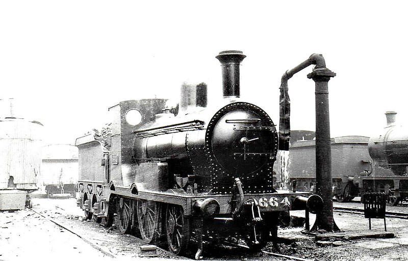 Class G 2 - 664 - M&GWR Class K 2-4-0, built 1896 by Broadstone Works as M&GWR No.23 SYLPH - 1923 rebuilt as Class Ks, 1925 to GSR as No.664, 1930 rebuilt, 1934 rebuilt with Belpaire boiler, 1941 rebuilt with round topped boiler, 1945 to CIE, 1950 rebuilt with Belpaire boiler - withdrawn 1961 - seen here at Broadstone Works.