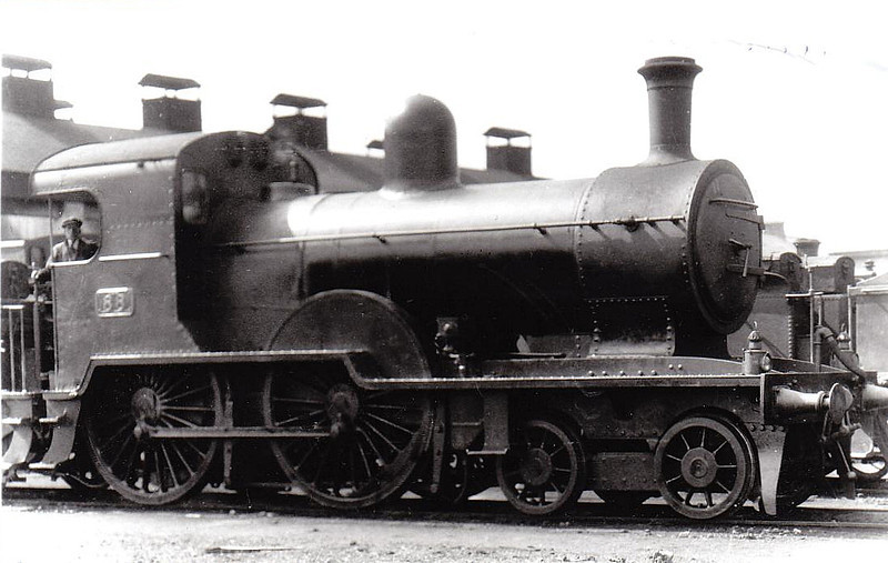 Class D14 - 88 - GS&WR Class 60 4-4-0 - built 1886 by Inchicore Works - 1925 to GSR, 1935 rebuilt with Belpaire boiler, superheated, 1945 to CIE - withdrawn 1957 - seen here at Limerick, 06/32.