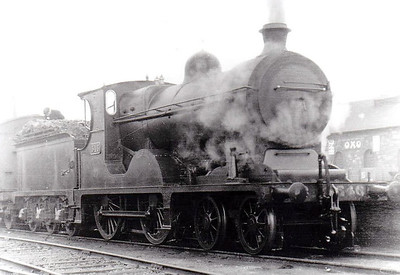 Class D 5 - 546 - M&GWR Class A 4-4-0, built 1902 by Broadstone Works as Midland & Great Western Railway No.129 CELTIC - 1918 rebuilt with Belpaire boiler, 1925 to GSR, 1945 to CIE - withdrawn 1959 - seen here at Broadstone on a Galway train in 1932.