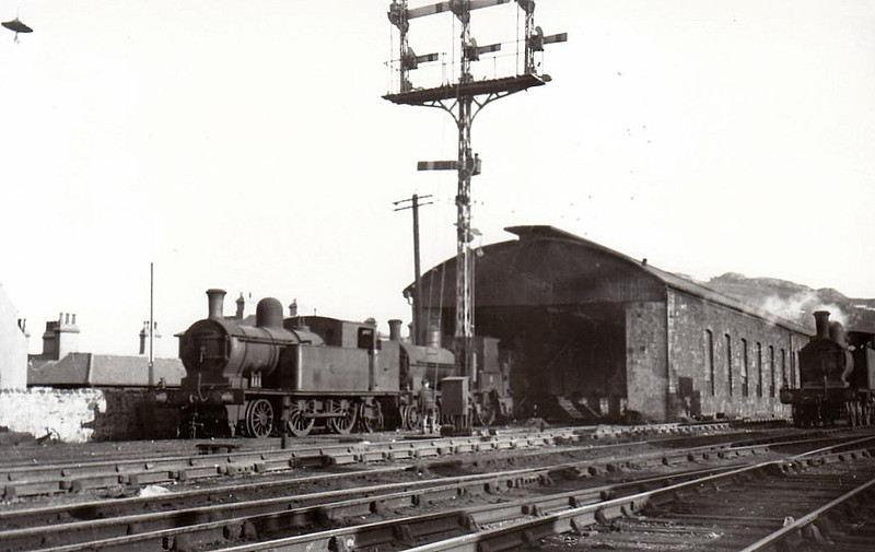 BRAY MOTIVE POWER DEPOT - Bray was at the outer limit of Dublin suburban services and the depot there has quite a roster of small tank engines - an ex DSER Class 258 2-4-2T stands in front of a very old 4-4-0, while a 4-4-2T is seen on the right, 09/49 - note odd signal.