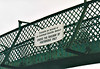 KILDARE RAILWAY STATION - The bi-lingual sign on the footbridge at Kildare, October 2002.