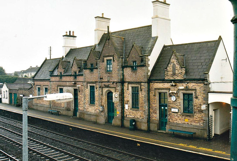 KILDARE RAILWAY STATION - Opened in 1846, Kildare is the first major stop west of Dublin and terminus of the outer suburban system from the capital. It is also the site of track maintenance depot. There are 2 platform tracks and a through line for freight. The station closed to freight traffic in 1976. Seen here in October 2002.