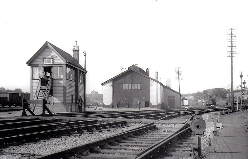 MALLOW STATION - signalbox and goods shed, 09/55, with J15 approaching on a goods train.