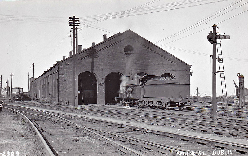 AMIENS STREET LOCOMOTIVE DEPOT, Dublin - The small GNR(I) depot in Dublin, still in use today. The 0-6-0 may be a member of Class SG and the railcar tucked away on the left is one of the two Class C built for Dublin - Howth services.