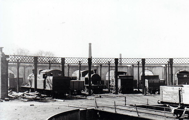 BROADSTONE ENGINE SHED - a selection of locos gathered around the turntable in the roofless shed in 1955.