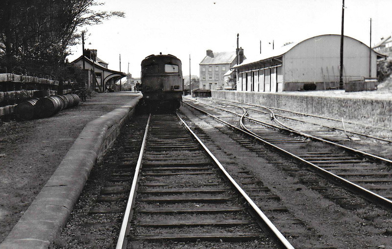 CLONAKILTY STATION - a terminus opened by the West Cork Railway in August 1886, the station closed completely in April 1961. A Class C diesel is seen standing in the platform.