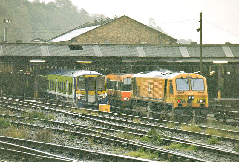 CORK MOTIVE POWER DEPOT - Class 201 No.216 and Class 2600 DMU 2610 on depot in the pouring rain, 24/10/02.