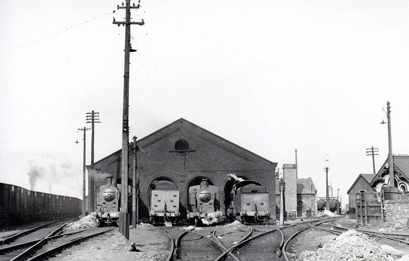 DUBLIN AMIENS STREET - the small running shed with a selection of GNR(I) locos outside, seen in 1955. The shed is still operational at the renamed Dublin Connolly. Note rake of sugar beet wagons to left.