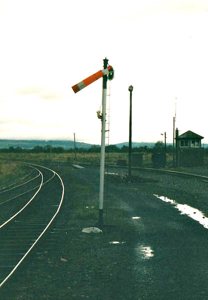 LIMERICK JUNCTION - A bleak spectacle! Nevertheless, the wonderful Irish semaphore signal, painted day-glo orange and tapering away from the post, 24/10/02.