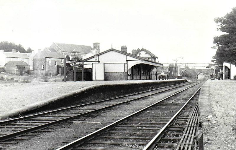 CLONAKILTY JUNCTION STATION - facing towards Bantry, Clonakilty Junction was opened by the West Cork Railway in June 1866, closing to passengers in April 1961. Note the Clonakilty Branch train behind the station building, 04/55.