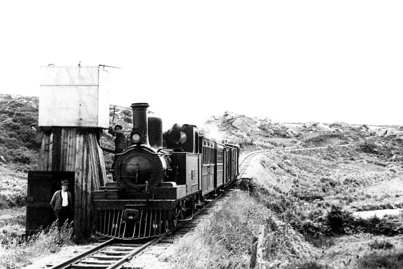 SCHULL & SKIBBEREEN LIGHT RAILWAY - No.4S - 4-4-OT - built 1888 by Nasmyth Wislon & Co., Works No.341, as S&SLR No.4 ERIN - 1925 to GSR as No.4S - 1945 to CIE - withdrawn 1954 - seen here  taking water at Leamawaddra Bridge - first locomotive in British Isles to be fitted with a Belpaire boiler.