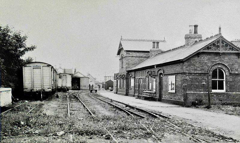 CASTLEDERG & VICTORIA BRIDGE TRAMWAY - CASTLEDERG - Terminus of the 7.25 mile roadside tramway in the year that it closed, 1933. It cannot be totally moribund because I think I can see the front of a locomotive in the shed doorway.