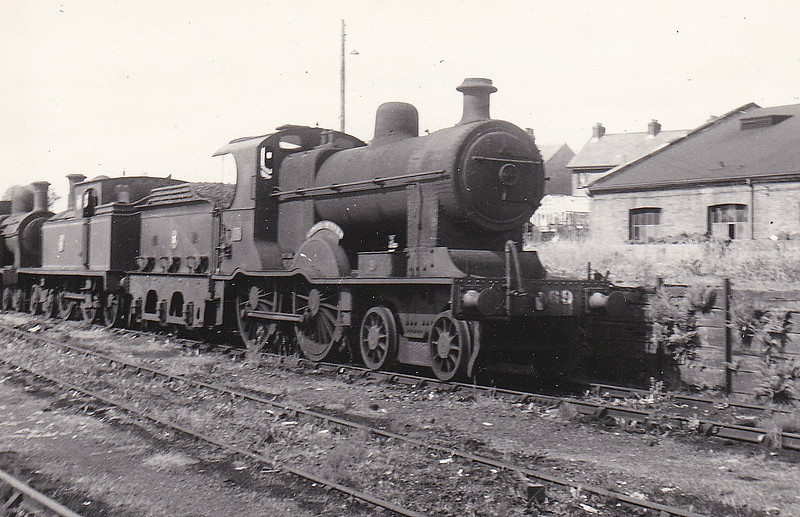 Class A1 - 69 SLIEVE BANE - MRNCC Class A 4-4-0 - built 1904 by Derby Works as MRNCC No.9 - 1923 to LMSNCC - 1925 to LMSNCC No.69 - 1933 rebuilt to Class A1 (Belpaire Superheated Boiler), named SLIEVE BANE - 1949 to UTA - 1954 withdrawn - seen here at Ballymena in June 1952.