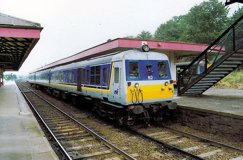 82 - Class 80 DEMU - 9 sets built by BREL in 1974, 4x3-car, 5x2-car. supplemented by a further build of 12 sets in 1977/9. With the arrival of CAF-built Class 3000 units in 2008, all were withdrawn but six were retained and formed into 4 car units of 2 power cars and two trailers, trailers coupled inwards - seen here at Lisburn on the 1335 Portrush - Belfast on 18/08/93.